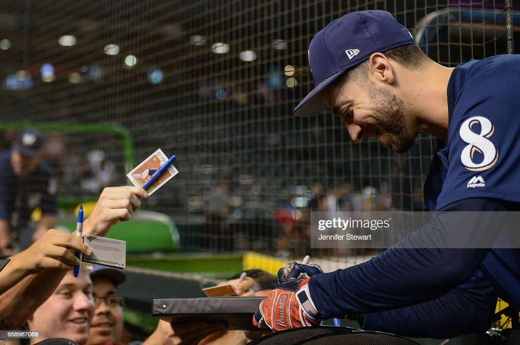 Ryan Braun #8 of the Milwaukee Brewers signs an autograph for fans prior to the MLB game against the Arizona Diamondbacks at Chase Field on May 15, 2018 in Phoenix, Arizona.