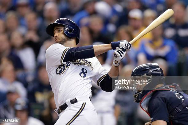 Ryan Braun of the Milwaukee Brewers singles in the bottom of the fourth inning against the Atlanta Braves during Opening Day at Miller Park on March...