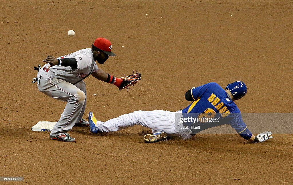 Ryan Braun #8 of the Milwaukee Brewers steals second base past Brandon Phillips #4 of the Cincinnati Reds in the sixth inning at Miller Park on September 23, 2016 in Milwaukee, Wisconsin.