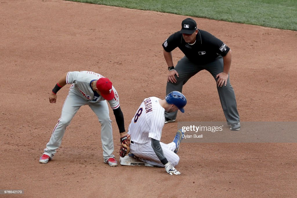 Ryan Braun #8 of the Milwaukee Brewers steals second base past Cesar Hernandez #16 of the Philadelphia Phillies in the fifth inning at Miller Park on June 16, 2018 in Milwaukee, Wisconsin.