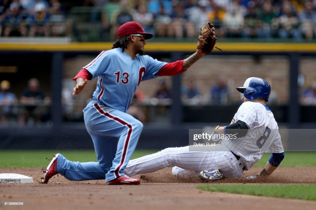 Ryan Braun #8 of the Milwaukee Brewers steals second base past Freddy Galvis #13 of the Philadelphia Phillies in the first inning at Miller Park on July 16, 2017 in Milwaukee, Wisconsin.