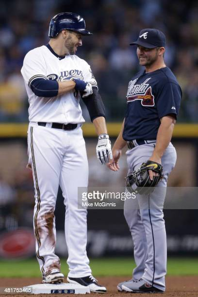 Ryan Braun of the Milwaukee Brewers talks to Dan Uggla of the Atlanta Braves after hitting a single in the bottom of the fourth inning against the...
