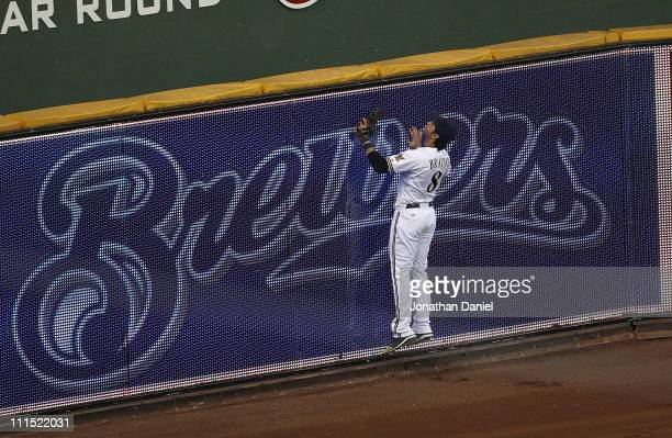 Ryan Braun of the Milwaukee Brewers watches as a home run ball hit by Martin Prado of the Atlanta Braves sails out of the park in the 8th inning...