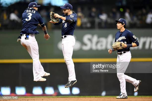 Ryan Braun, Orlando Arcia Christian Yelich of the Milwaukee Brewers celebrate after defeating the Los Angeles Dodgers in Game One of the National...