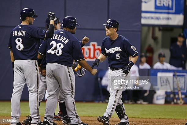 Ryan Braun, Prince Fielder, and Geoff Jenkins of the Milwaukee Brewers celebrate Jenkins' grand slam home run in a game against the Minnesota Twins...