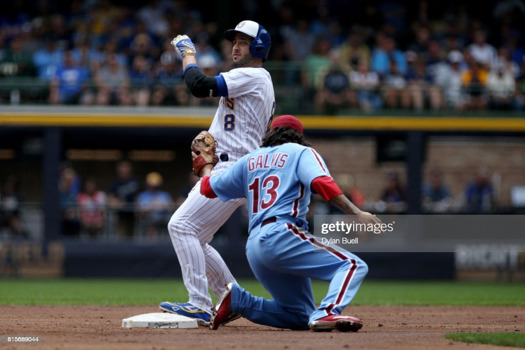 Ryan Braun #S8 of the Milwaukee Brewers steals second base past Freddy Galvis #13 of the Philadelphia Phillies in the first inning at Miller Park on July 16, 2017 in Milwaukee, Wisconsin.