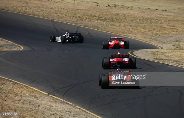 Ryan Briscoe driver of the Dreyer Reinbold Dallara Honda chases Dan Wheldon in the Target Ganassi Racing Dallara Honda during the IRL IndyCar Series...