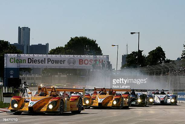 Ryan Briscoe driver of the Penske Racing Porsche RS Spyder leads the pack into the first corner on the first lap of the American Le Mans Series...