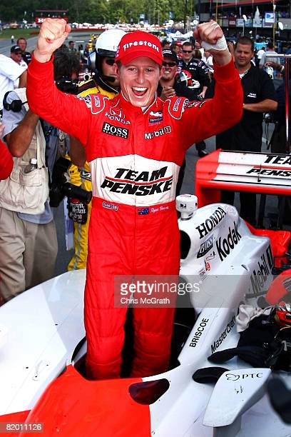 Ryan Briscoe driver of the Team Penske Dallara Honda celebrates victory during the IRL IndyCar Series The Honda Indy 200 on July 20 2008 at the...