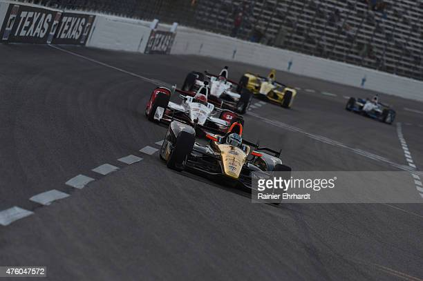 Ryan Briscoe of Australia driver of the Arrow/Lucas Oil Schmidt Peterson Honda leads a pack of cars during practice for the Verizon IndyCar Series...