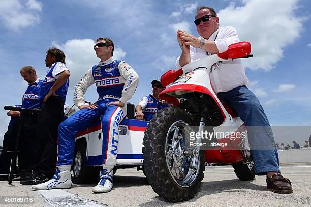 Ryan Briscoe of Australia driver of the NTT Data Chip Ganassi Racing Dallara Chevrolet sits with team owner Chip Ganassi during NTT DATA Qualifying...