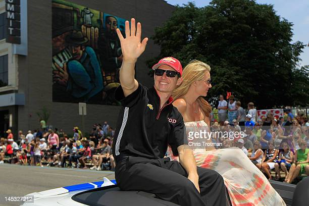 Ryan Briscoe of Australia driver of the Team Penske Dallara Chevrolet and his wife Nicole Briscoe wave to fans during the Indianapolis 500 Festival...
