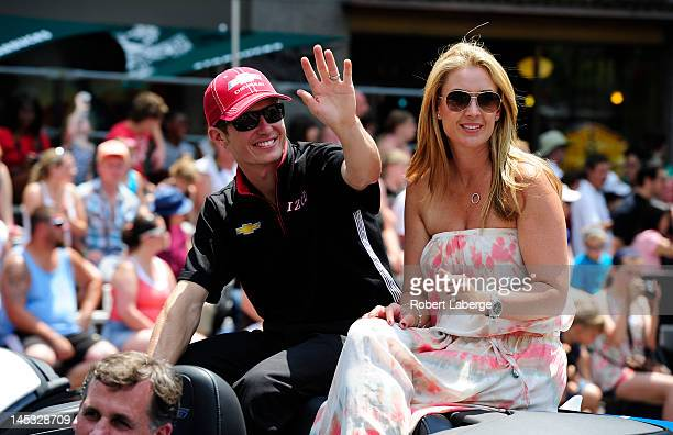 Ryan Briscoe of Australia driver of the Team Penske Dallara Chevrolet and his wife Nicole during the Indianapolis 500 Festival Parade part of the...