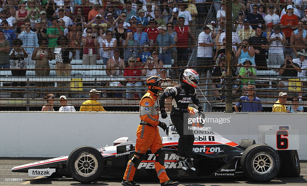 Ryan Briscoe of Australia gets out of the #6 Team Penske Dallara Honda after wrecking during the IZOD IndyCar Series 94th running of the Indianapolis 500 at the Indianapolis Motor Speedway on May 30, 2010 in Indianapolis, Indiana.