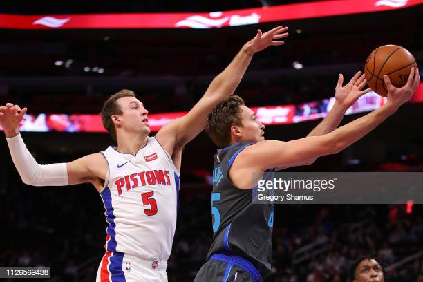 Ryan Broekhoff of the Dallas Mavericks drives to the basket past Luke Kennard of the Detroit Pistons during the first half at Little Caesars Arena on...