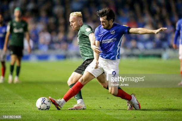 Ryan Broom of Plymouth Argyle holds off John Marquis of Portsmouth FC during the Sky Bet League One match between Portsmouth and Plymouth Argyle at...