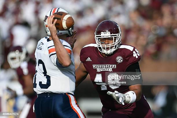 Ryan Brown of the Mississippi State Bulldogs pressures Jarod Neal of the Tennessee Martin Skyhawks during the first quarter of a game at Davis Wade...