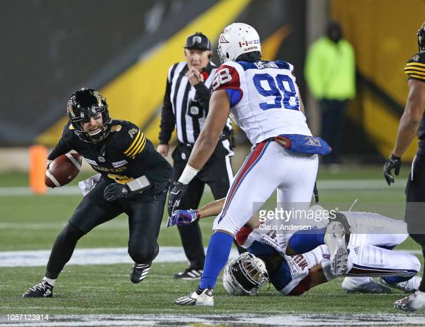 Ryan Brown of the Montreal Alouettes looks to take down Dane Evans of the Hamilton TigerCats in a CFL game at Tim Hortons Field on November 3 2018 in...