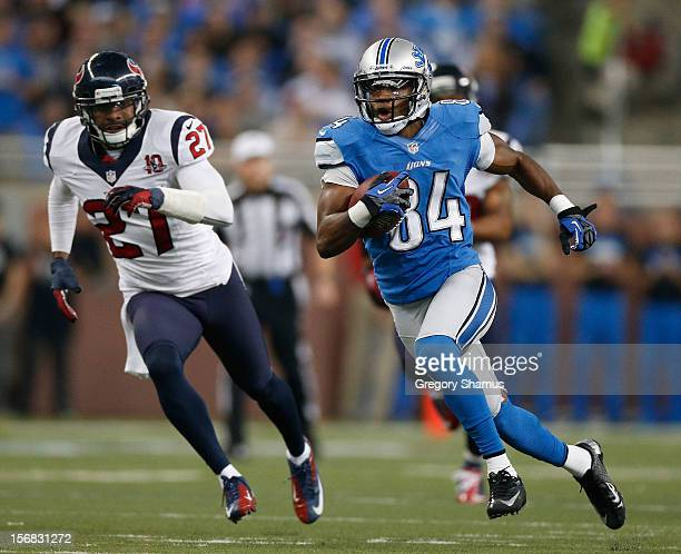 Ryan Broyles of the Detroit Lions runs for extra yards after a second quarter catch in front of Quintin Demps of the Houston Texans at Ford Field on...