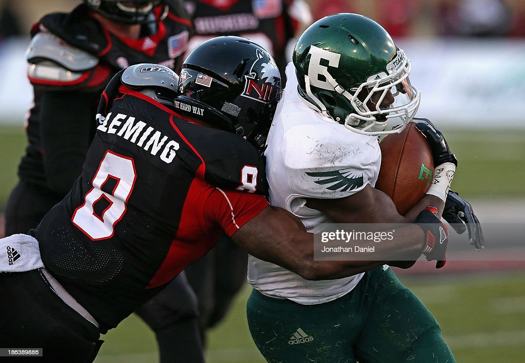 Ryan Brumfield #22 of the Eastern Michigan Eagles is hit by Ladell Fleming #8 of the Northern Illinois Huskies at Brigham Field on October 26, 2013 in DeKalb, Illinois. Northern Illinois defeated Eastern Michigan 59-20.