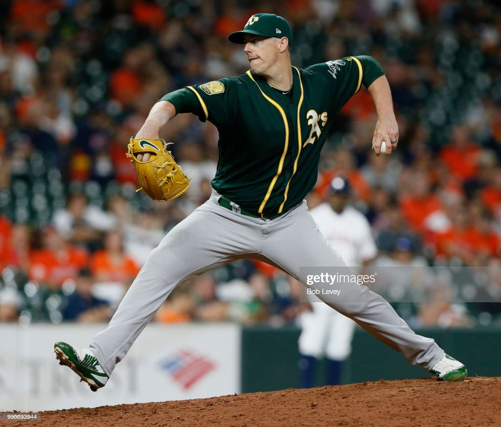 Ryan Buchter #52 of the Oakland Athletics pitches in the ninth inning against the Houston Astros at Minute Maid Park on July 11, 2018 in Houston, Texas.