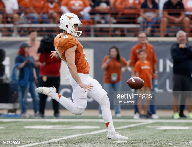 Ryan Bujcevski of the Texas Longhorns punts the ball in the first half during the OrangeWhite Spring Game at Darrell K RoyalTexas Memorial Stadium on...
