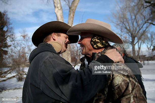 Ryan Bundy a member of an antigovernment militia hugs LaVoy Finicum a rancher from Arizona at the Malheur National Wildlife Refuge Headquarters on...
