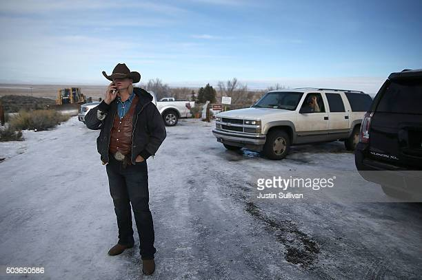 Ryan Bundy a member of an antigovernment militia talks on the phone in front of the Malheur National Wildlife Refuge Headquarters on January 6 2016...