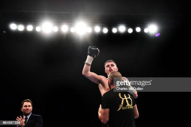 Ryan Burnett of Northern Ireland celebrates after his bout with Zhanat Zhakiyanov of Kazakhstan for the IBF WBO and IBO World Bantamweight...