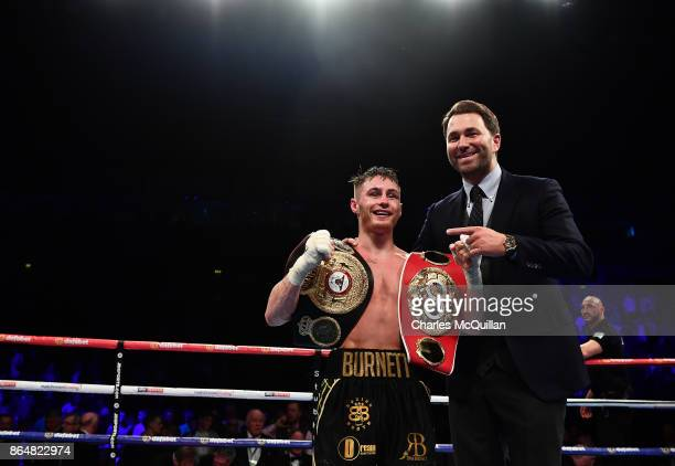 Ryan Burnett of Northern Ireland celebrates with Eddie Hearn after his bout with Zhanat Zhakiyanov of Kazakhstan for the IBF WBO and IBO World...