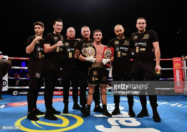 Ryan Burnett of Northern Ireland celebrates with his team after his bout with Zhanat Zhakiyanov of Kazakhstan for the IBF WBO and IBO World...
