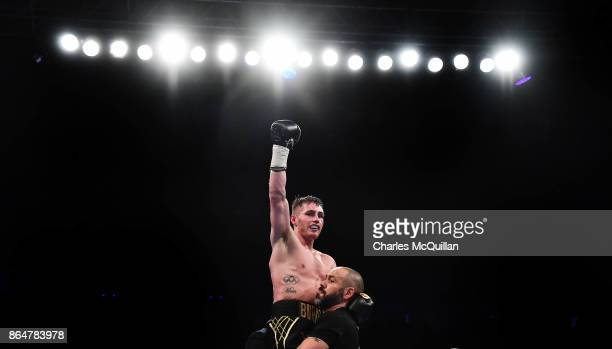 Ryan Burnett of Northern Ireland is declared the winner after his bout with Zhanat Zhakiyanov of Kazakhstan for the IBF WBO and IBO World...