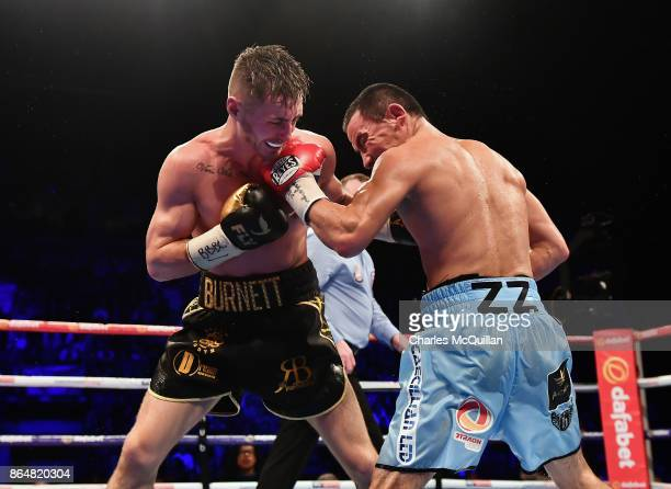 Ryan Burnett of Northern Ireland v Zhanat Zhakiyanov of Kazakhstan during their IBF WBO and IBO World Bantamweight Championship bout at SSE Arena...