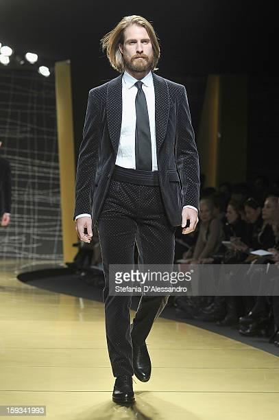 Ryan Burns walks the runway during the Ermenegildo Zegna show as part of Milan Fashion Week Menswear Autumn/Winter 2013 on January 12, 2013 in Milan,...