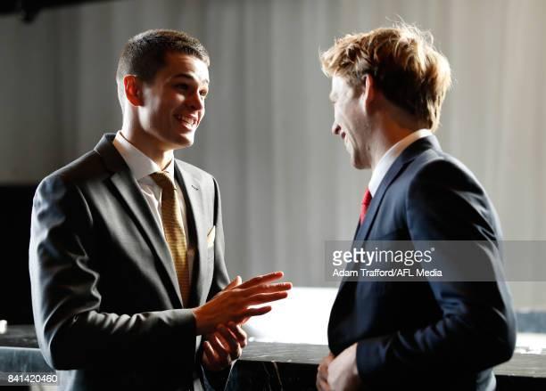 Ryan Burton of the Hawks chats to last years winner Callum Mills of the Swans during the 2017 NAB AFL Rising Star awards at Peninsula at Atlantic on...