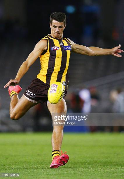Ryan Burton of the Hawks kicks the ball during the AFLX match night at Etihad Stadium on February 16 2018 in Melbourne Australia