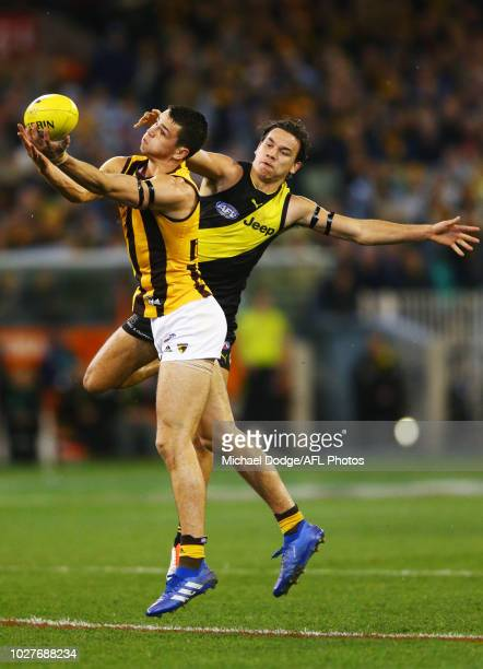 Ryan Burton of the Hawks marks the ball against Daniel Rioli of the Tigers during the AFL First Qualifying Final match between the Richmond Tigers...