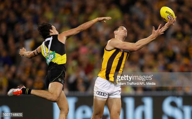 Ryan Burton of the Hawks marks the ball ahead of Daniel Rioli of the Tigers during the 2018 AFL First Qualifying Final match between the Richmond...