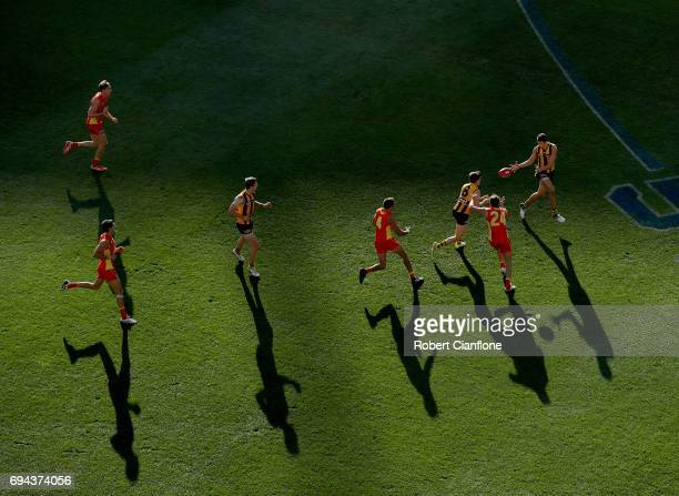 Ryan Burton of the Hawks takes the ball during the round 12 AFL match between the Hawthorn Hawks and the Gold Coast Suns at Melbourne Cricket Ground...