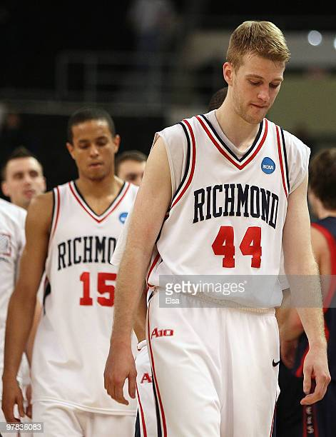 Ryan Butler and Francis-Cedric Martel of the Richmond Spiders walks off the court after they lost to the Saint Mary's Gaels during the first round of...