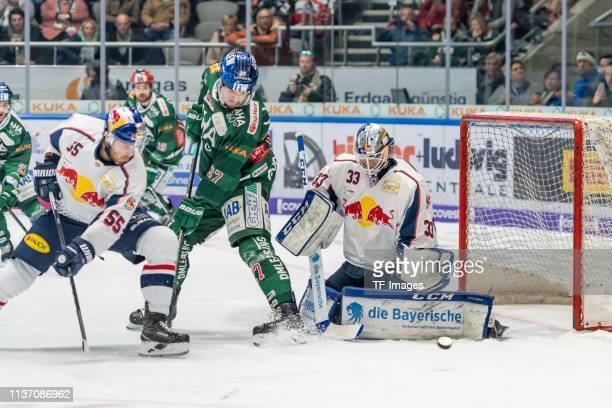 Ryan Button of EHC Red Bull Muenchen Matt Fraser of Augsburger Panther and goalkeeper Danny aus den Birken of EHC Red Bull Muenchen battle for the...