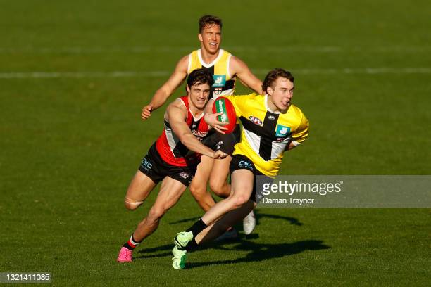Ryan Byrnes of the Saints runs with the ball during a St Kilda Saints AFL training session at RSEA Park on June 03, 2021 in Melbourne, Australia.