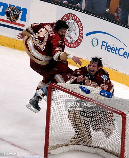 BOSTON MAAPRIL 10TH 2004 Ryan Caldwell left jumps in the air to greet goalie Adam Berkhoel after Denver defeated Maine in the NCAA 2004 Men's hockey...