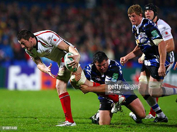 Ryan Caldwell of Ulster evades a challenge from Duncan Bell of Bath during the Heineken Cup pool Four match between Ulster and Bath held at Ravenhill...