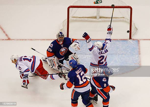 Ryan Callahan and Brandon Dubinsky of the New York Rangers celebrate a goal by teammate Sean Avery as Evgeni Nabokov Josh Bailey and Mark Streit of...