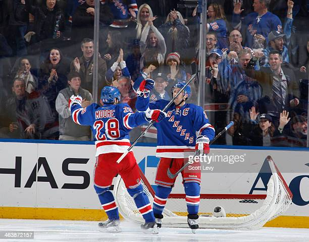 Ryan Callahan and Dominic Moore of the New York Rangers celebrate after a second period goal against the Washington Capitals at Madison Square Garden...