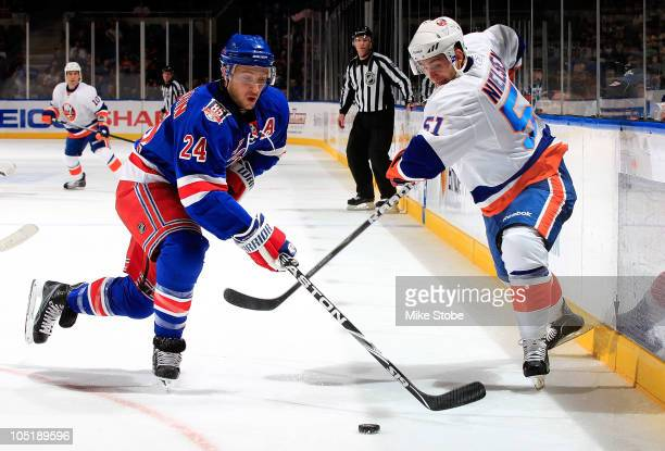 Ryan Callahan of the New York Rangers battles for the puck against Frans Nielsen of the New York Islanders on October 11 2010 at Nassau Coliseum in...