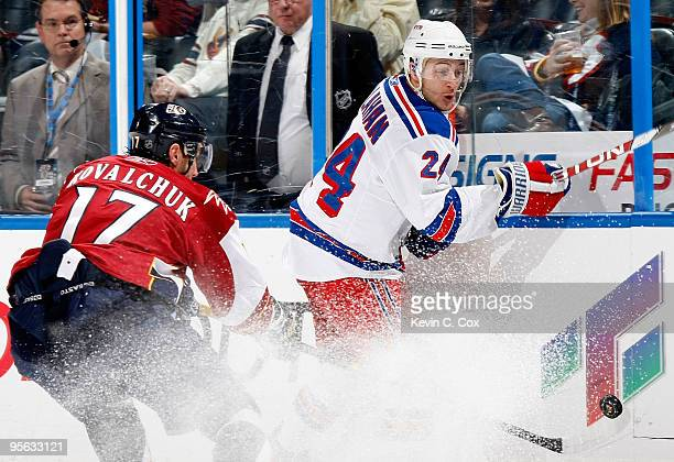 Ryan Callahan of the New York Rangers battles for the puck against Ilya Kovalchuk of the Atlanta Thrashers at Philips Arena on January 7 2010 in...