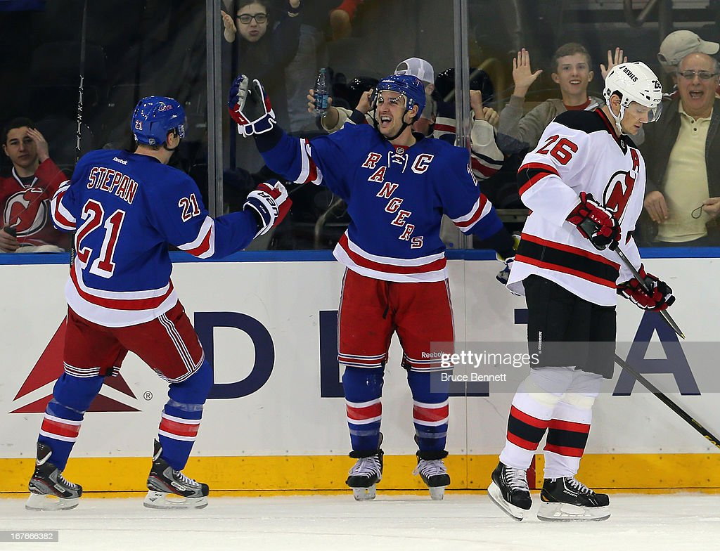 Ryan Callahan #24 of the New York Rangers celebrates his shorthanded goal at 19:01 of the first period against the New Jersey Devils along with Derek Stepan #21 (L) at Madison Square Garden on April 27, 2013 in New York City.