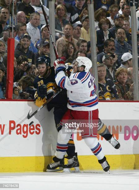 Ryan Callahan of the New York Rangers checks Jason Pominville of the Buffalo Sabres during Game 5 of the 2007 Eastern Conference Semifinals at HSBC...